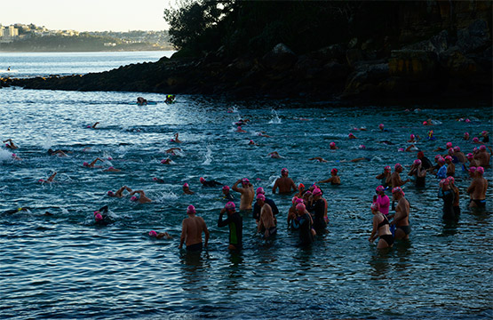 Swimmers start the 750-metre swim back to Manly Beach from Shelly Beach