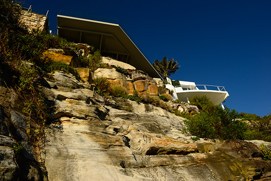 A seaside house perched atop the rocks at Fairy Bower, Manly