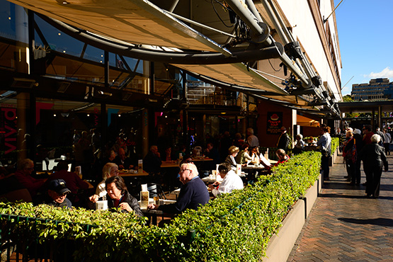 Outdoor eating areas looking out onto the wharves at Circular Quay, Sydney
