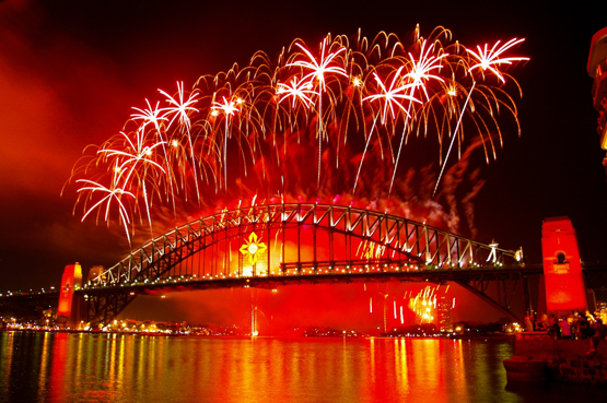 Sydney Harbour Bridge is bathed in red as a result of New year's Eve fireworks
