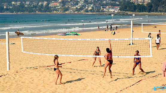 Women play beach volleyball at Manly Beach, Sydney