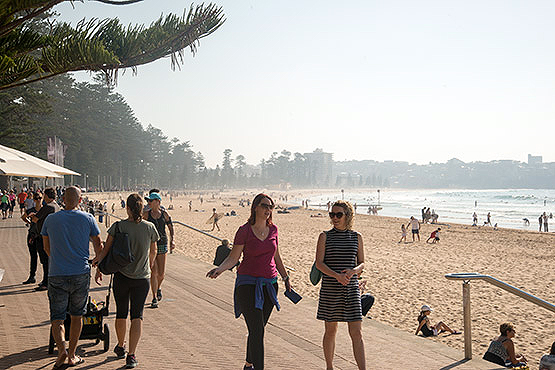 Women walk along the promenade at Manly Beach, Sydney