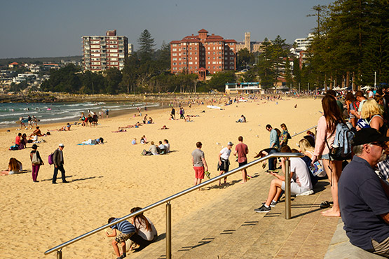 Beach-goers look for a spot to set up at Manly Beach, Sydney