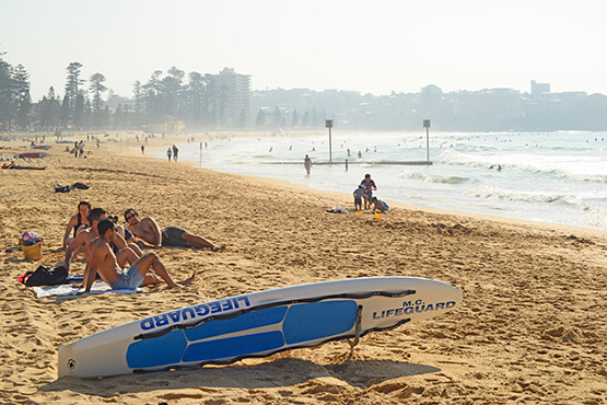 A lifeguard's rescue board lies ready at Manly Beach, Sydney