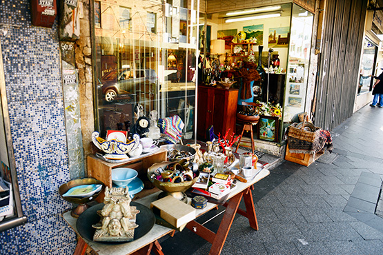 Wares are also displayed on trestles on the footpath in King Street, Newtown, in Sydney