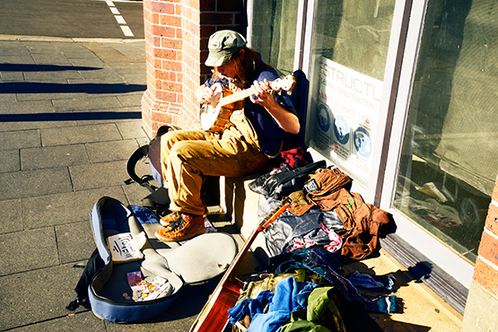 A busker sings for his supper in King Street, Newtown