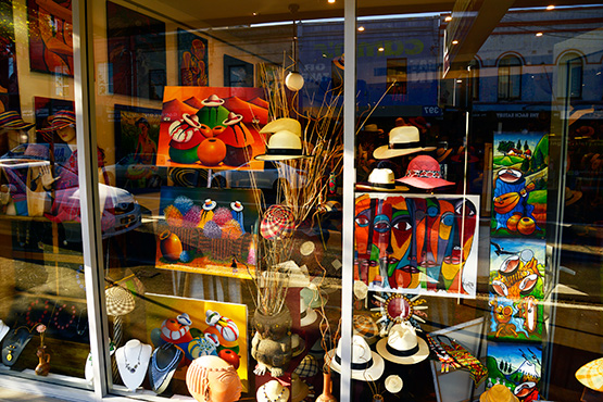 Shopfront window displays are bright, colourful and artistic in King Street, Newtown