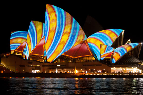 Sydney Opera House striped with bright, contarsting colours durung the Vivid Sydney festival