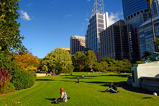 City workers enjoy their lunctime break in the Sydney Royal Botanic Gardens
