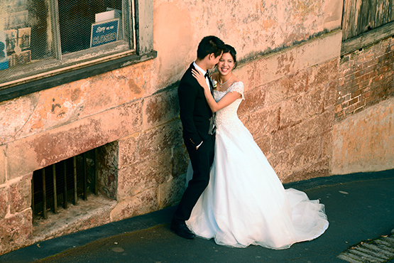 A bride and groom pose for their wedding pictures outside Susannah Place Museum in The Rocks, Sydney