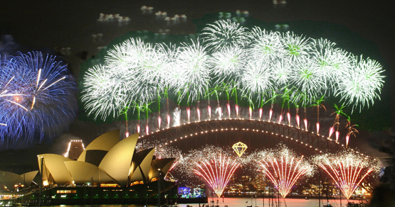 Sydney Harbour Bridge lit up with New Year's Eve fireworks