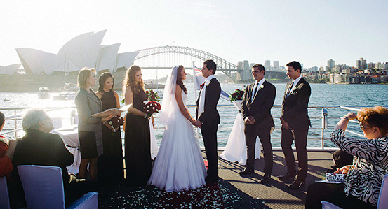 A couple get married aboard a cruise vessel on Sydney Harbour